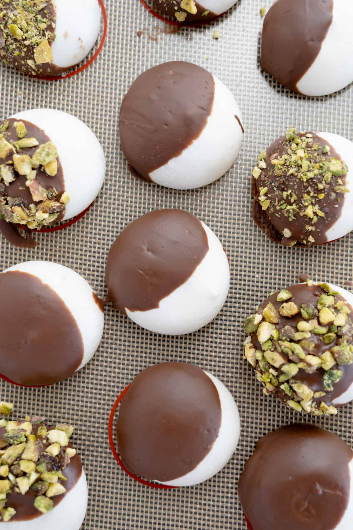 aquafaba cookies dipped into chocolate and pistachio
